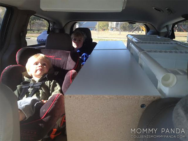 mommy-panda-blog-boys-in-van-with-bookcases